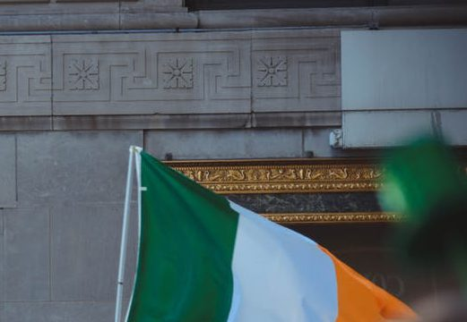 Man holding the Irish flag.
